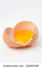 Raw broken egg on white background,