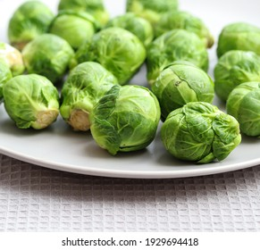 raw brussels sprouts on a plate close up