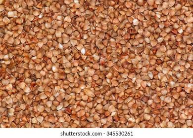 Raw buckwheat porridge background