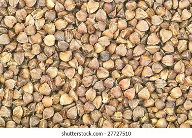Raw buckwheat seeds macro background pattern texture
