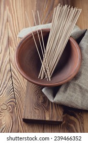 Raw buckwheat soba noodles in a ceramic plate, studio shot
