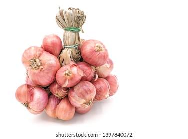 Raw bundle shallot onions isolate on  white background, Closeup Bundle shallot onions texture background, Fresh shallot