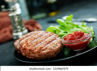 raw burger on plate on a table