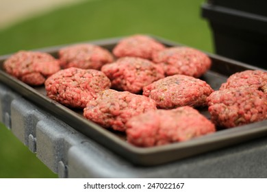 Raw Burger Patties about to be Grilled