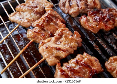 raw and burn toasted pork grilled on stove with fragrant smoke