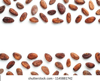 Raw cacao bean in creative layout on white background with space for text. Cacao beans isolated on white with clipping path. Copy space for text.
