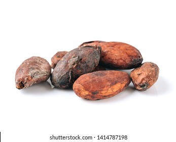 Raw cacao beans top view on white background. Close up view of raw cacao beans isolated on white with clipping path.