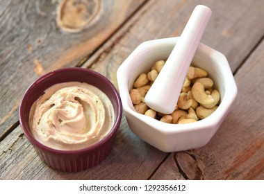 Raw cashew butter with mortar and pestle