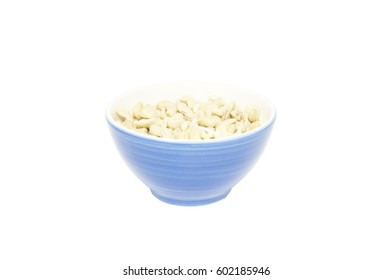 Raw cashews in blue bowl isolated on white background