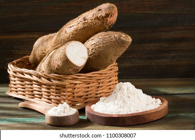 Raw cassava starch - Manihot esculenta. Wooden background