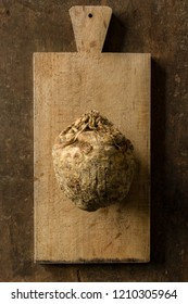 Raw Celeriac on a Wooden Chopping Board