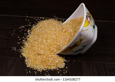 Raw Cereal Food Also Know as Bulgur, Dalia or Daliya Isolated on wooden Background