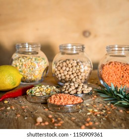 Raw cereals set on wooden background.