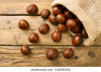 raw chestnuts on rustic background
