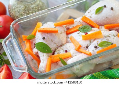 Raw chicken before baking in the oven with vegetables and spices