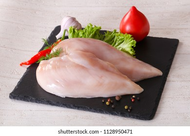 Raw chicken breast fillet