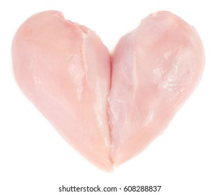 Raw chicken breast fillet in heart form isolated on white background.