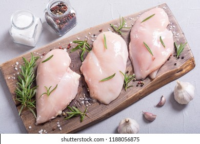 Raw chicken breast ( fillet ) with ingredient . Meat background