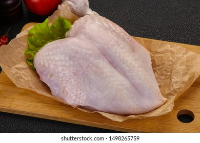 Raw chicken breast with skin