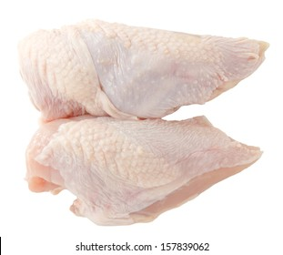 Raw chicken breast with skin isolated on white
