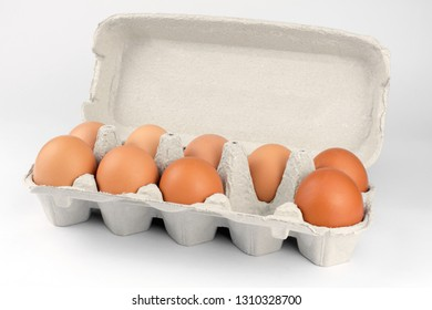 raw chicken eggs in egg box. white background
