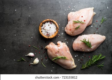 Raw chicken fillet with spices. Food background, cooking ingredients. Fresh meat. Chicken breast.