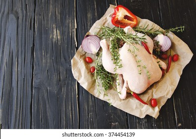 raw chicken with herbs spices ingredients, selective focus