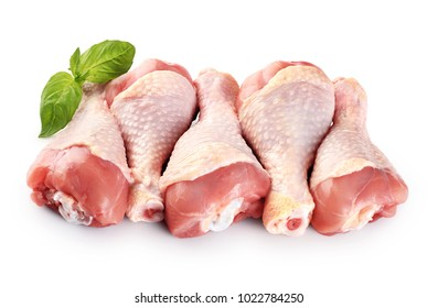 Raw chicken legs and basil isolated on white background.