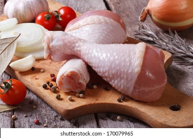 raw chicken legs and marinade ingredients on the kitchen board