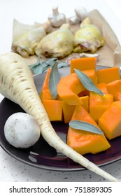 Raw chicken legs in tray cooking ingredients - pumpkin, chickpeas and potatoes