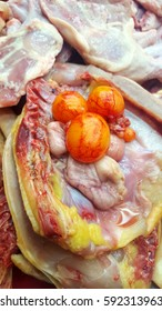 Raw chicken meat with embryo eggs in fresh market.
