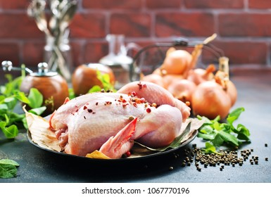 raw chicken and spice on a table, stock photo