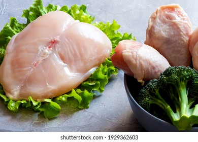 Raw chickenbreast and leg on the grey backgrond.