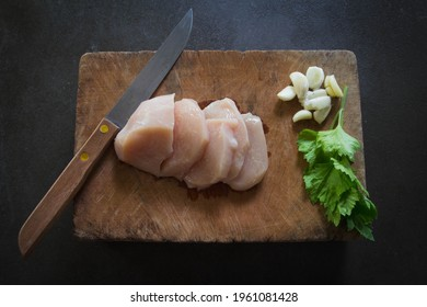 Raw chickenbreast  on Cutting board backgrond.