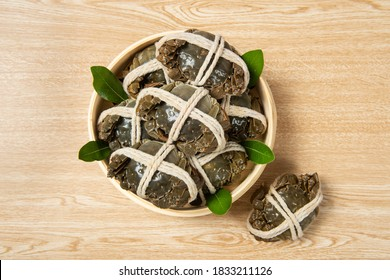 Raw Chinese mitten crab, shanghai hairy crab on wooden background.