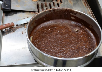 Raw chocolate in a pan. Chocolate paste in a pan.
