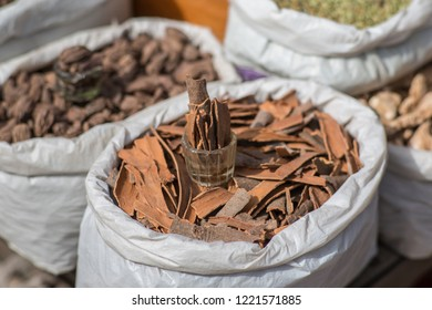 Raw cinnamon in a bag at a Indian spice market.