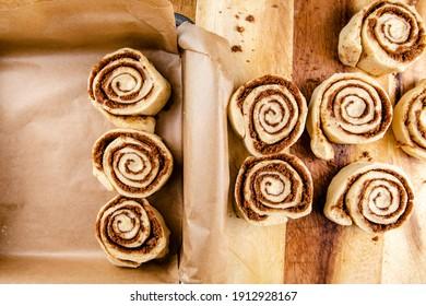 Raw cinnamon rolls prepared to bake