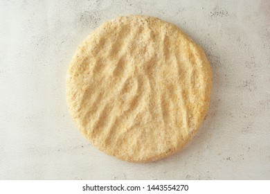 Raw circle dough. Pastry or bread dough. Bright background. Flat lay. Cooking process.