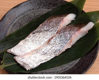 Raw cod fillet on a plate