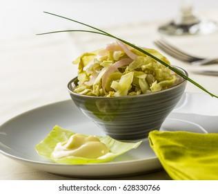 Raw collard greens salad served with mayonnaise.