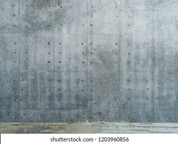 Raw concrete wall.