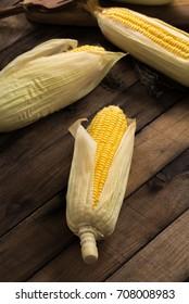 raw corn on wood