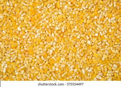 raw crushed corn groats close up