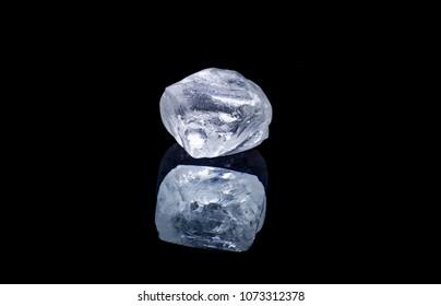 Raw diamond isolated on black background.