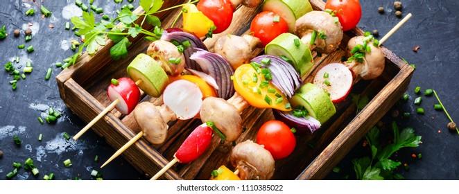 Raw diet kebab from fresh vegetables on skewers. Vegetables for grilling