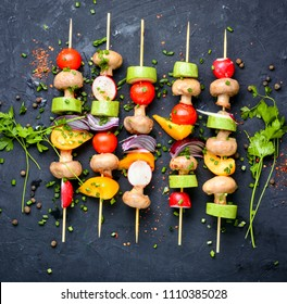 Raw diet kebab from fresh vegetables on skewers. Vegetables for grilling