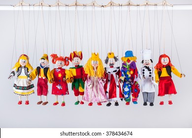 The raw of different puppets isolated on white