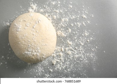 Raw dough on grey background