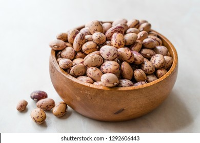 Raw Dry Pinto Beans on Marble Board with Wooden Bowl / Kidney Beans.